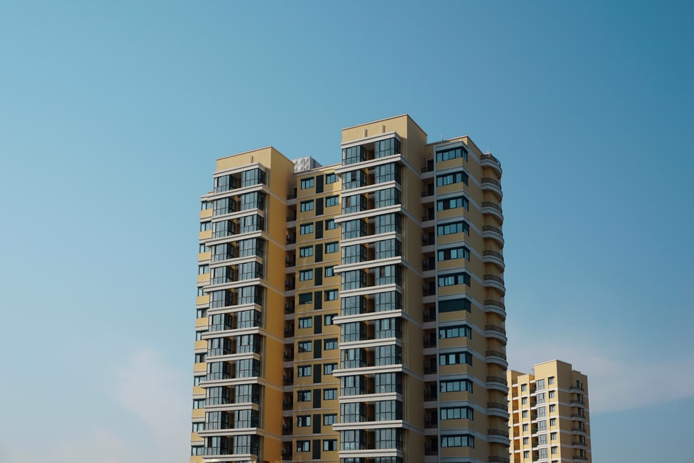brown and beige concrete building under blue sky during daytime