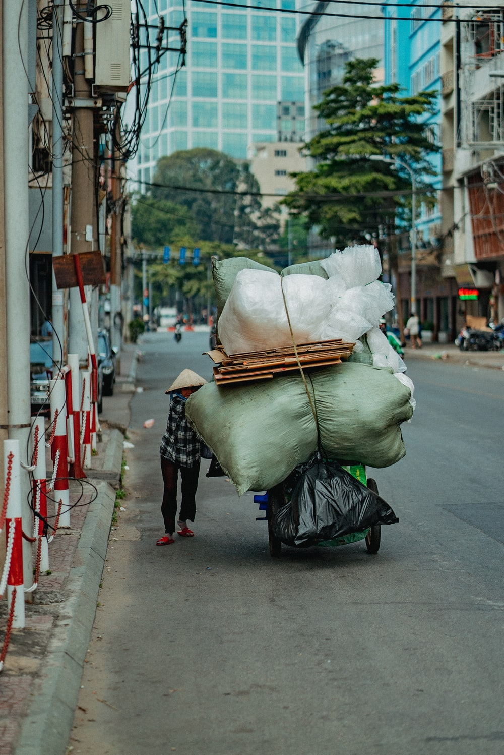 white plastic bags on sidewalk during daytime