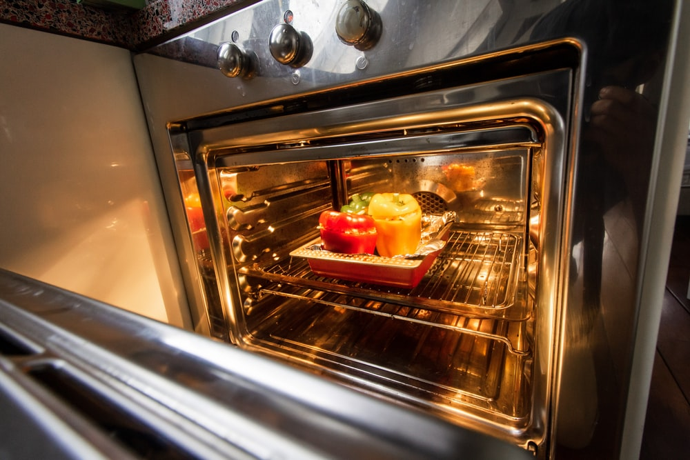 stainless steel oven with foods