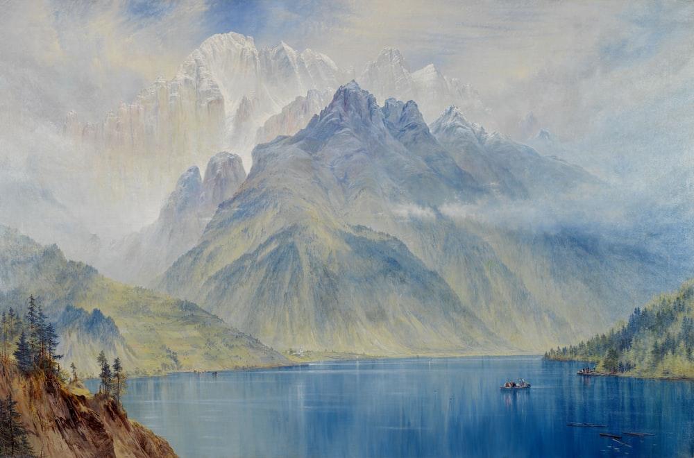 lake near mountain during daytime