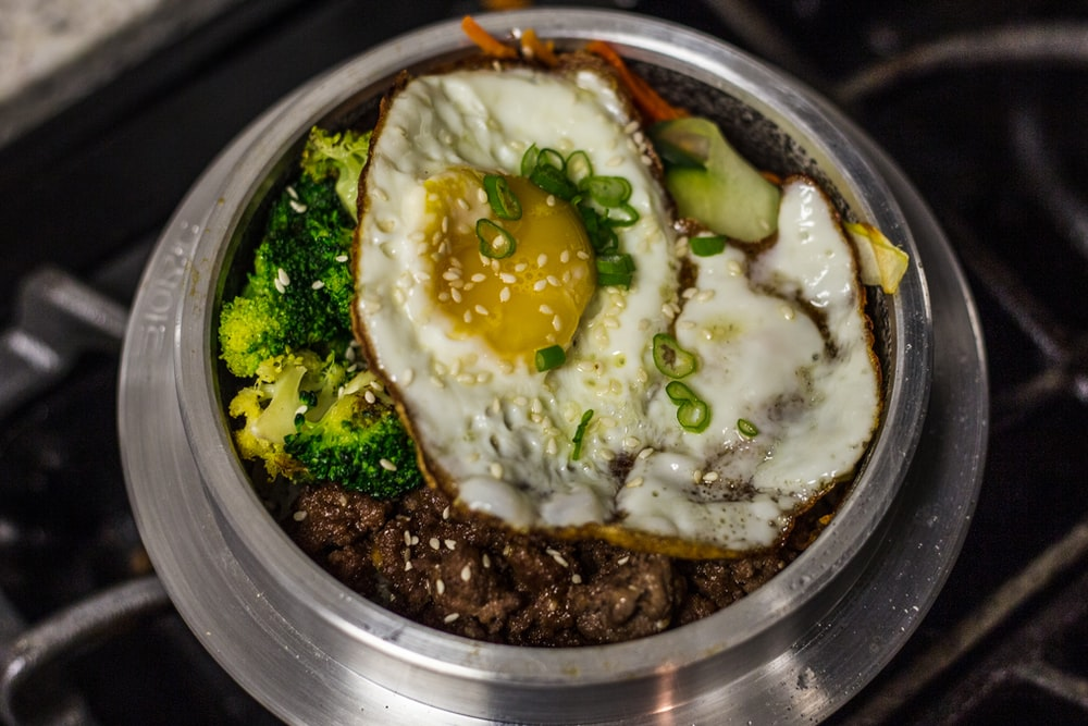 egg dish on stainless steel round plate