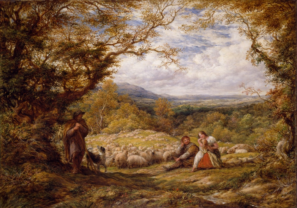 man and woman sitting on grass field painting
