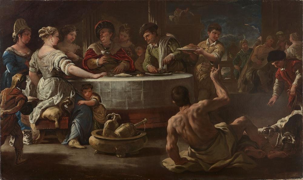 group of men sitting on brown wooden floor