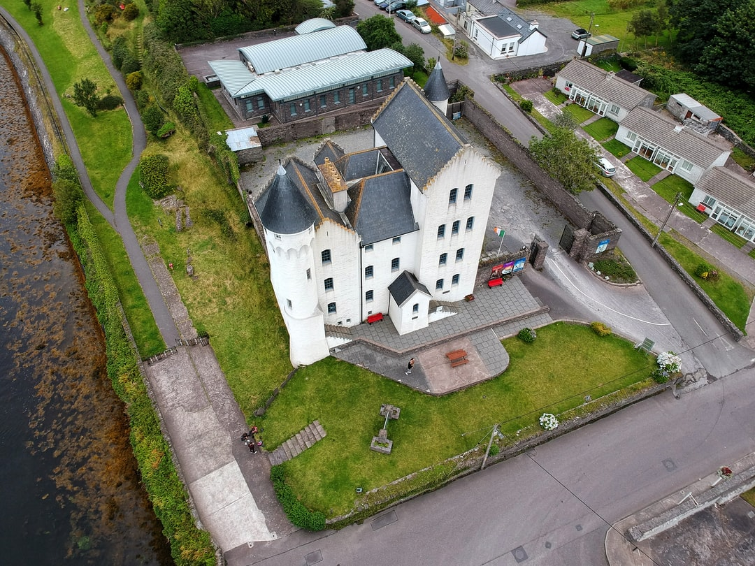 Drone aerial photo of an old building near a river🚁