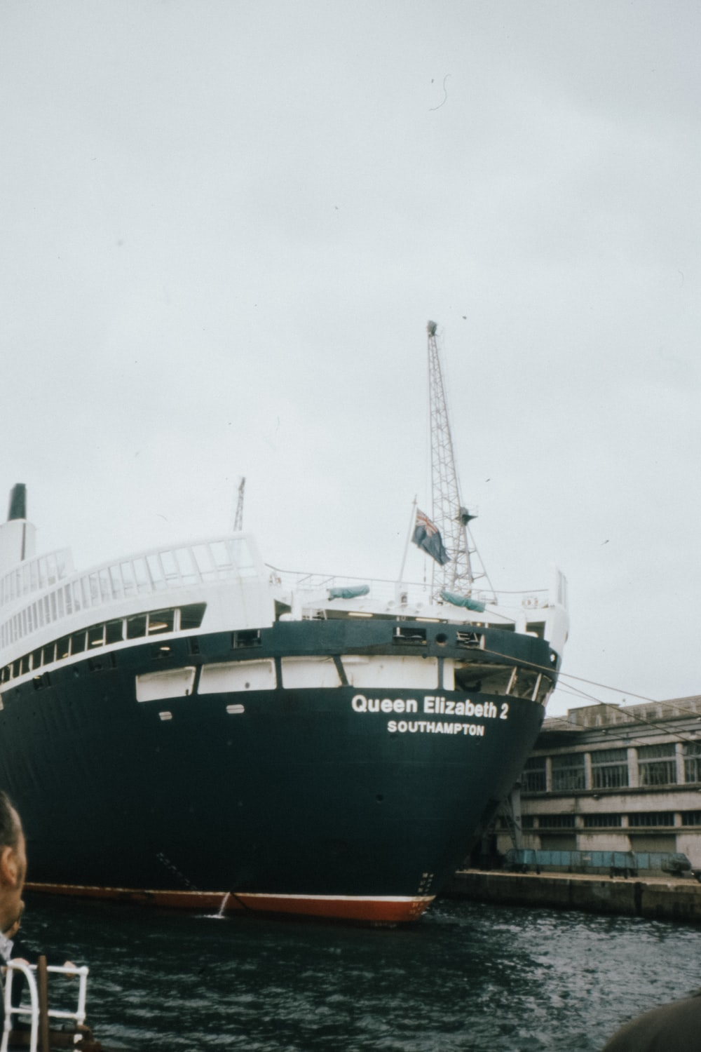 green and white ship on dock during daytime