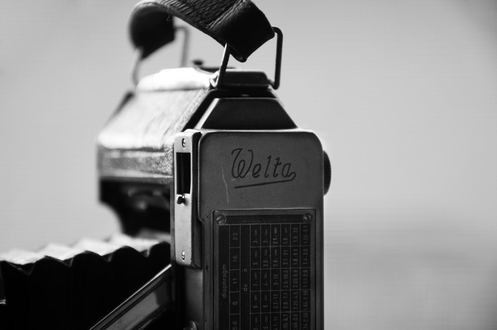 grayscale photo of black and gray vintage camera