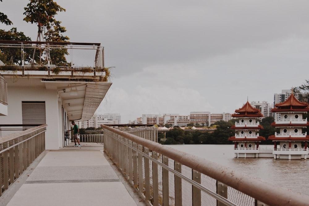 people walking on bridge near building during daytime