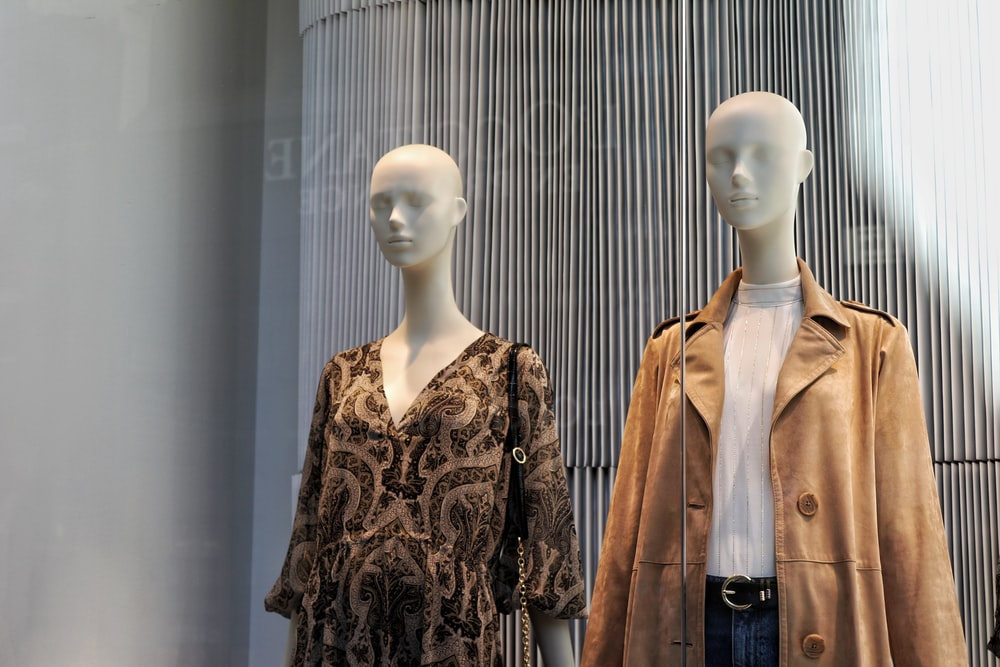 mannequin in brown and black floral coat