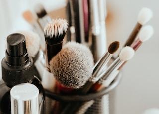 makeup brushes on black steel rack