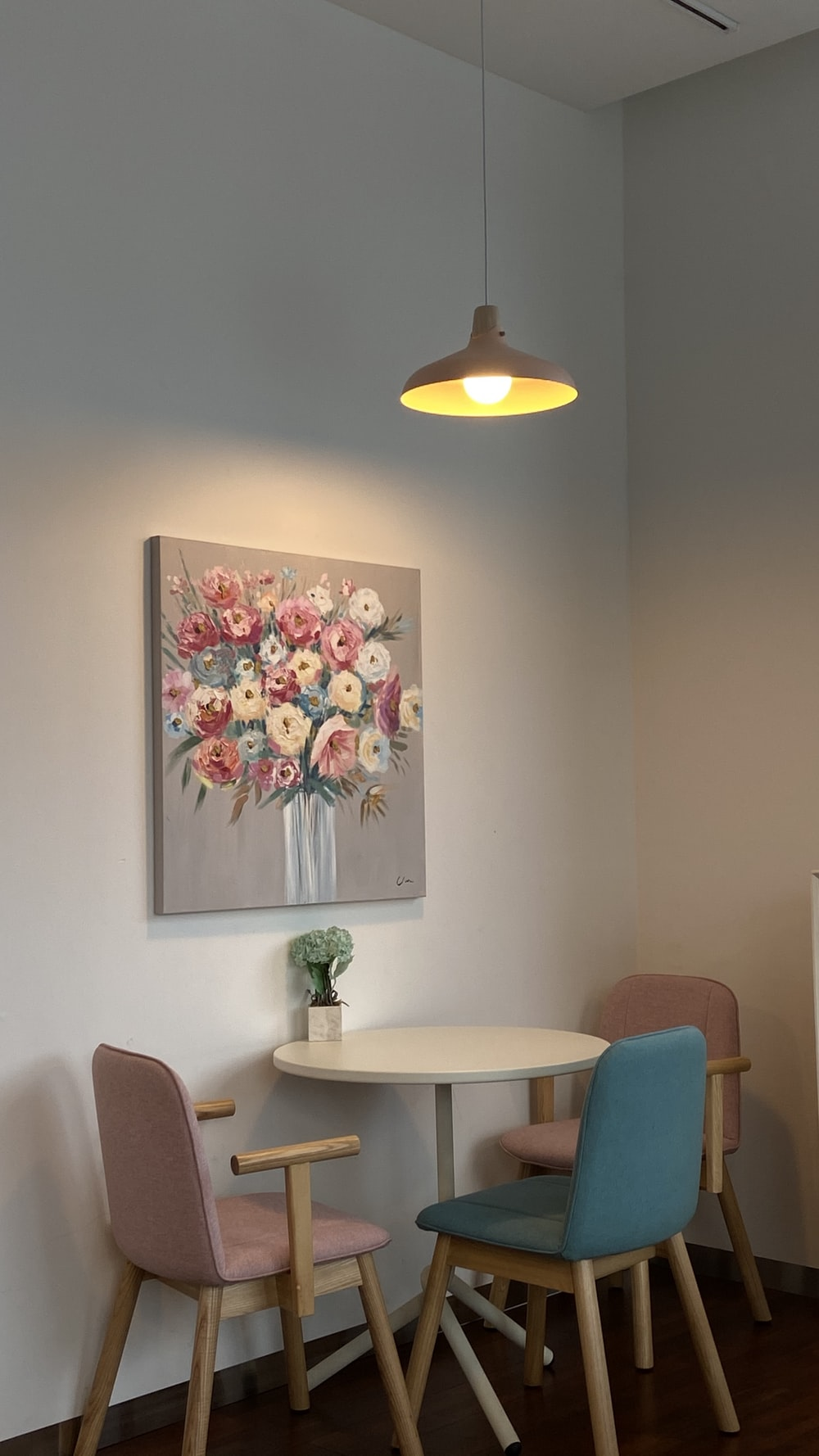 white and pink flower painting on wall
