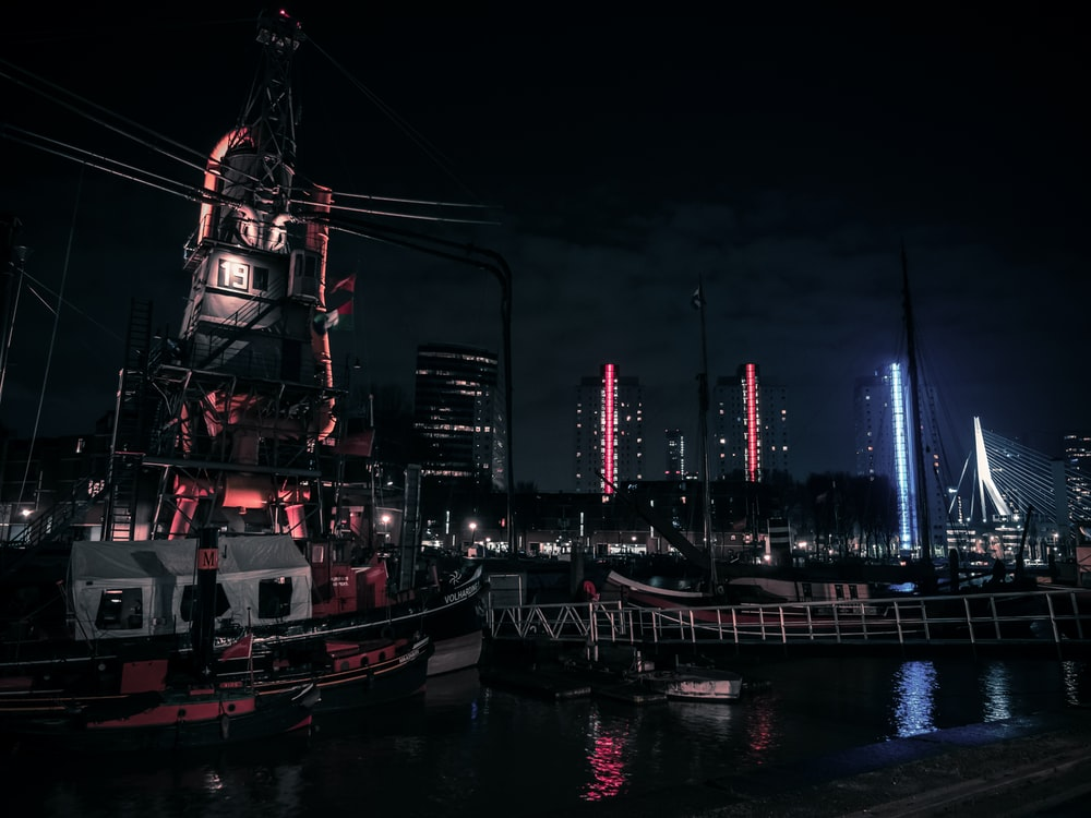 red and white boat on dock during night time