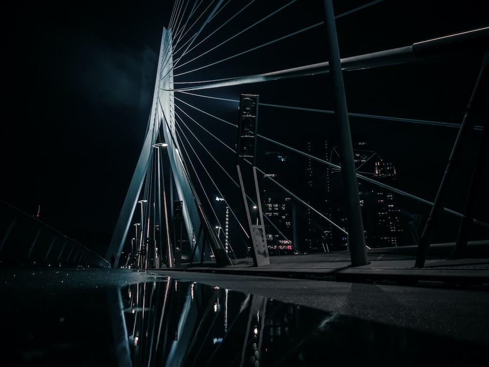grayscale photo of a bridge