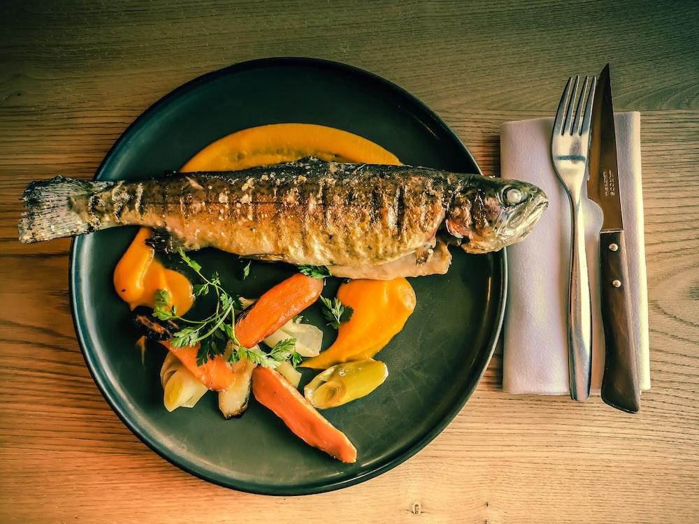 fish dish on blue ceramic plate