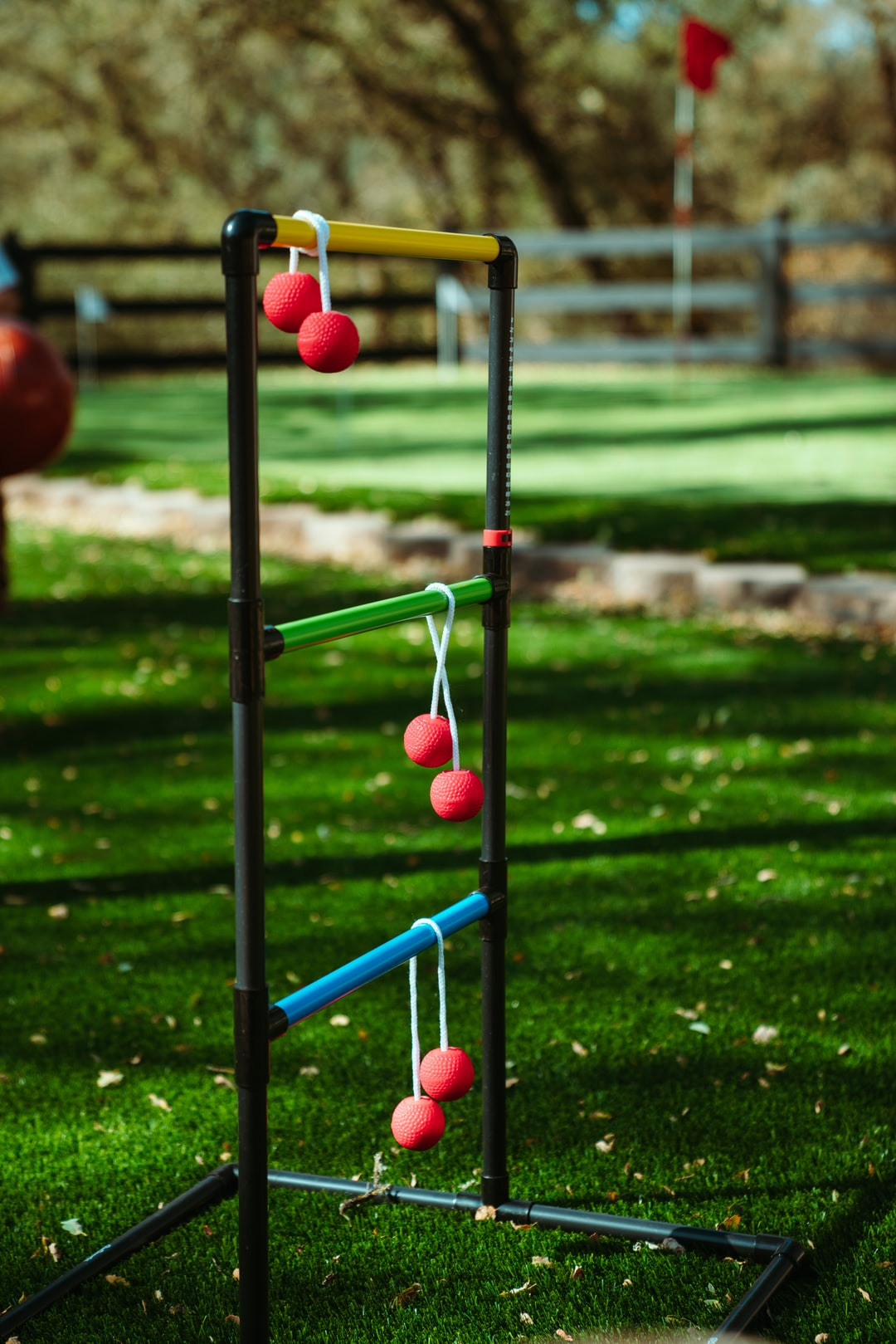 A game of ladder ball at a summer lawn party.
