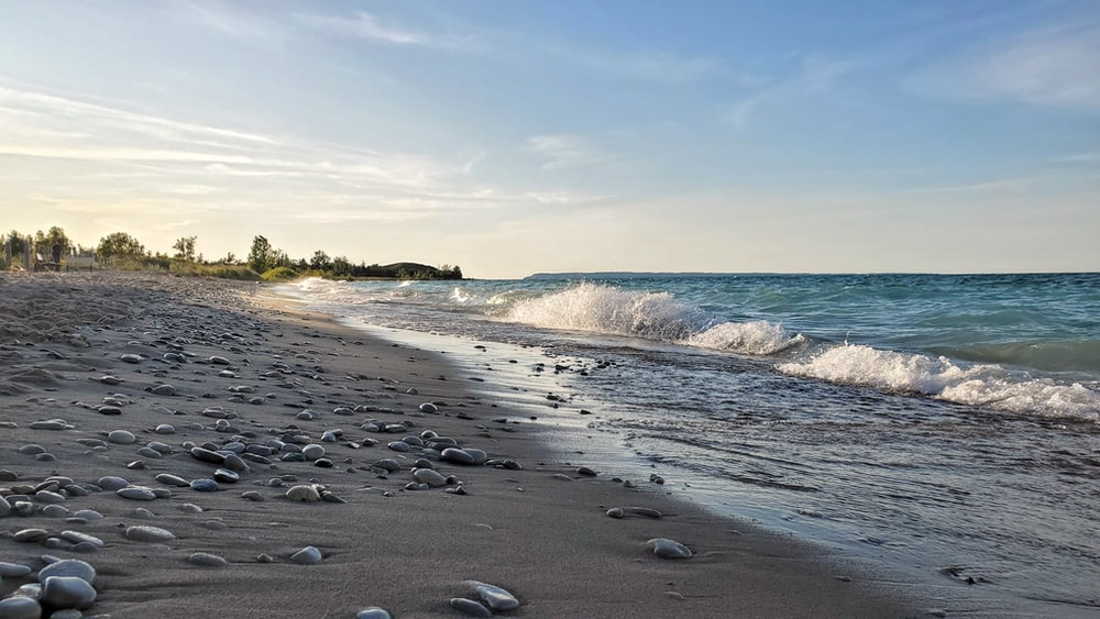 gray stones on seashore during daytime