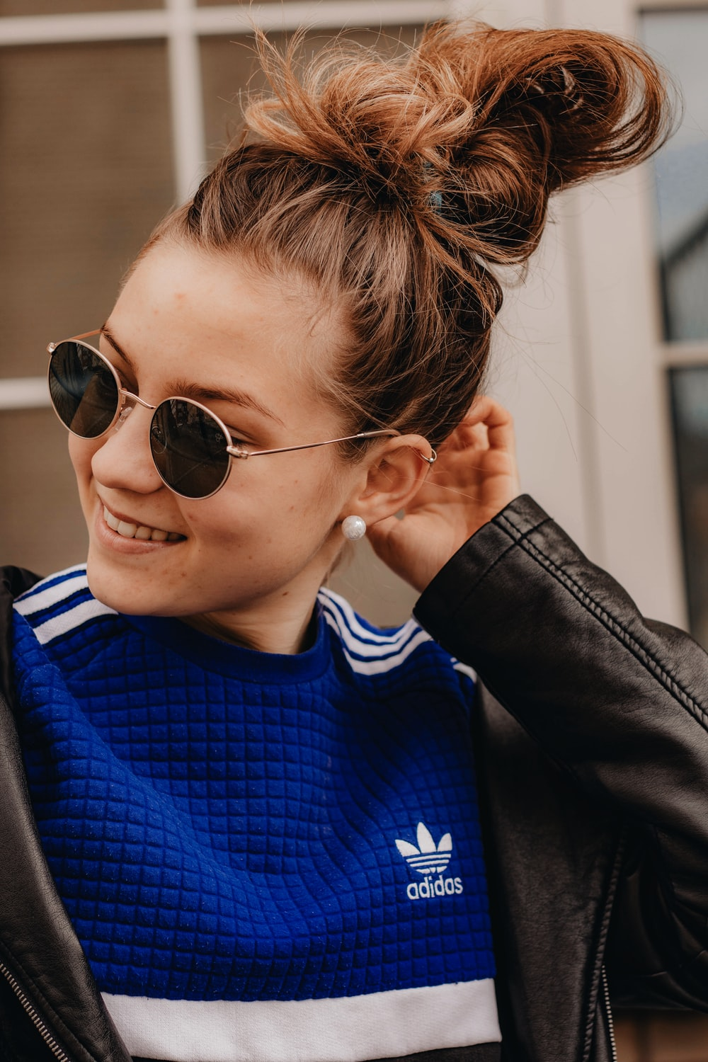 woman in blue and black sweater wearing black sunglasses