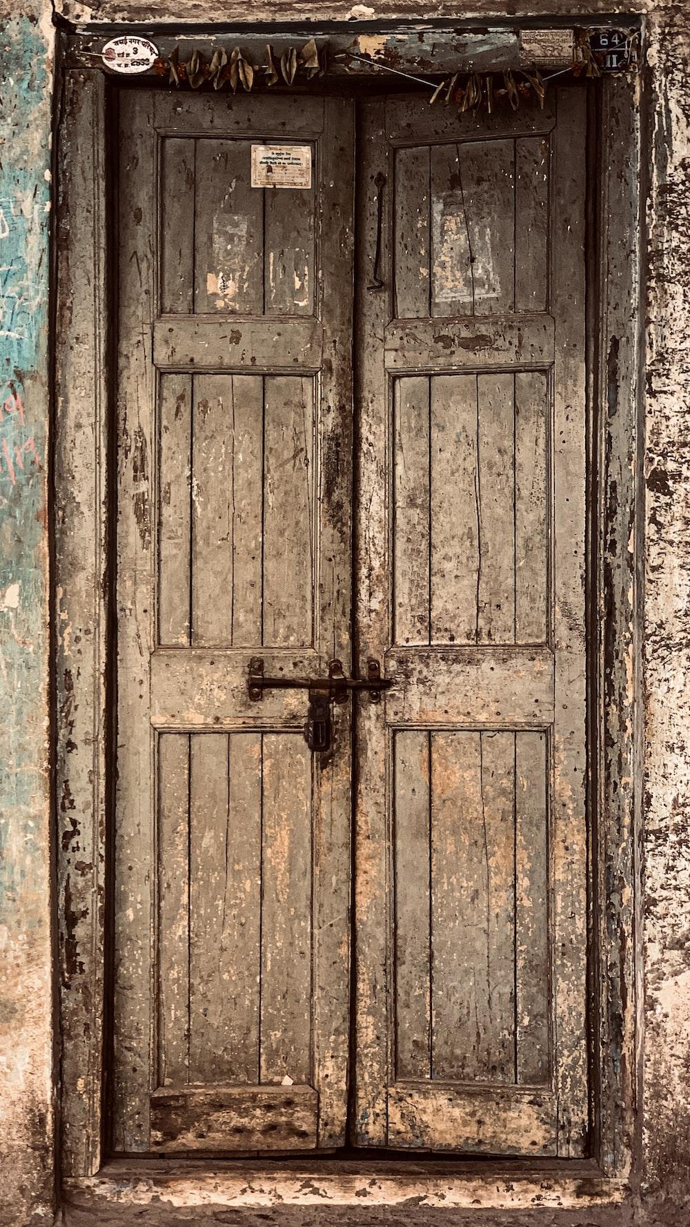brown wooden door with cross