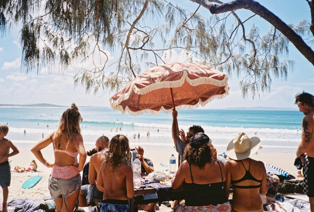 people sitting on beach during daytime