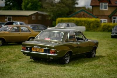 Luton brown sedan on green grass field during daytime