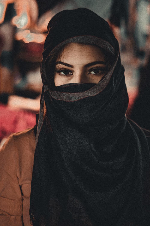 woman in black hijab standing