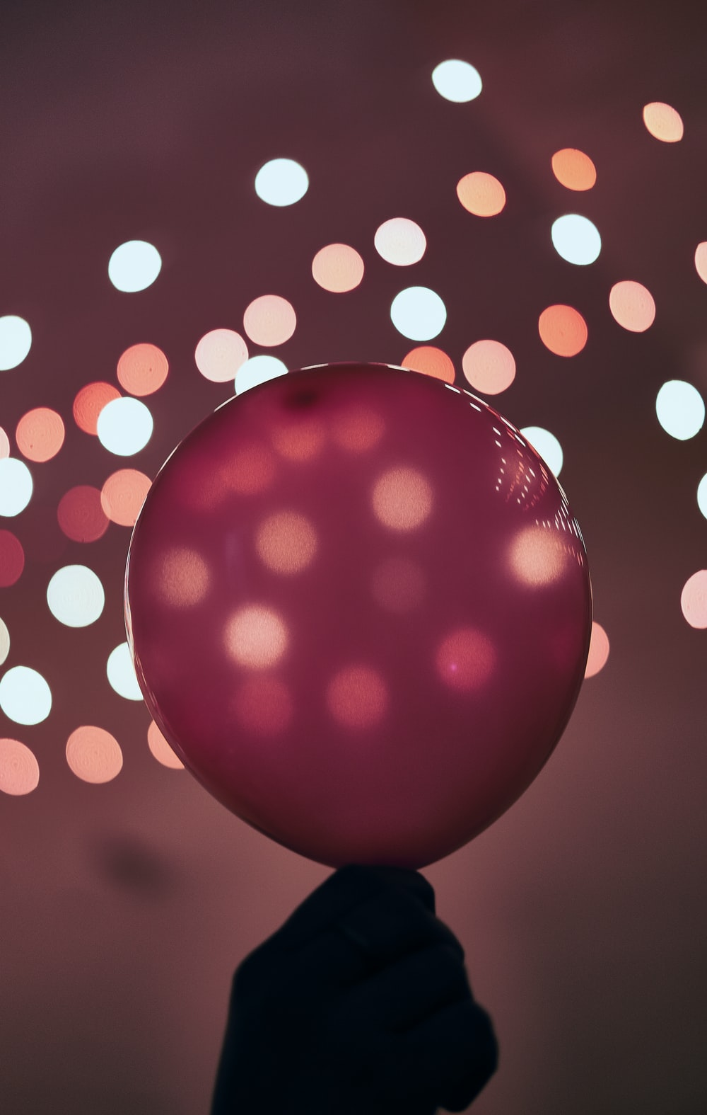 red and white polka dot ball