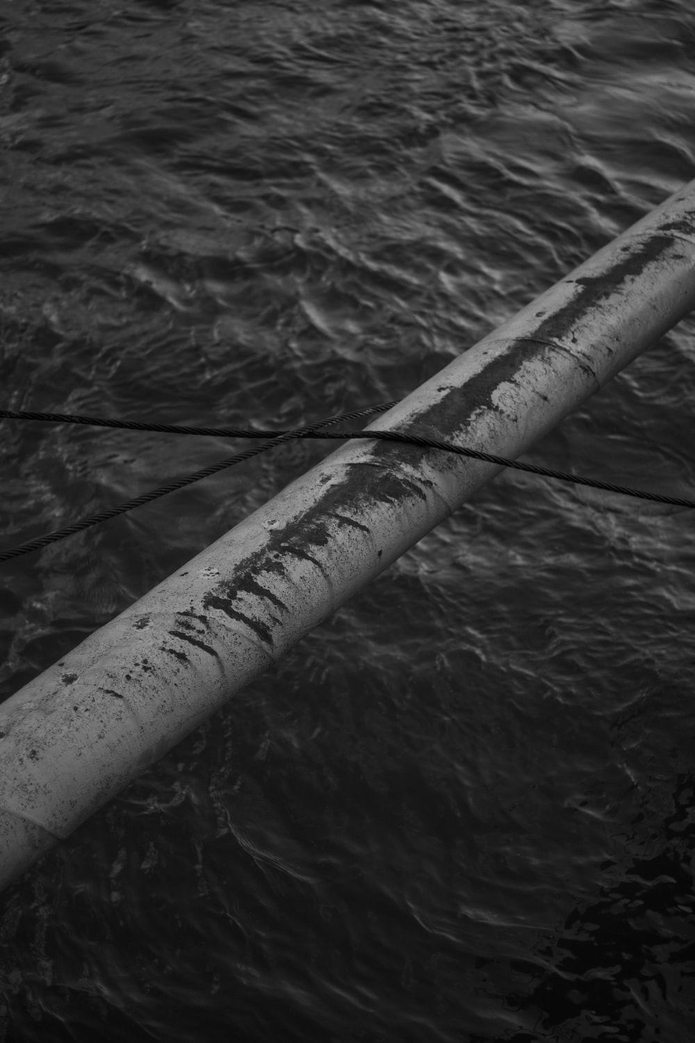 gray scale photo of a wooden stick