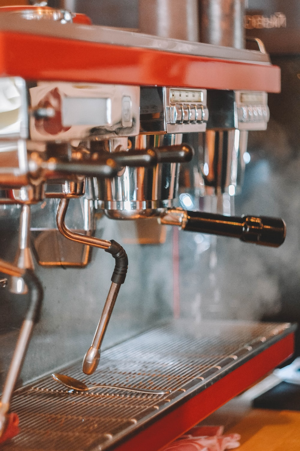 stainless steel espresso machine with coffee cup