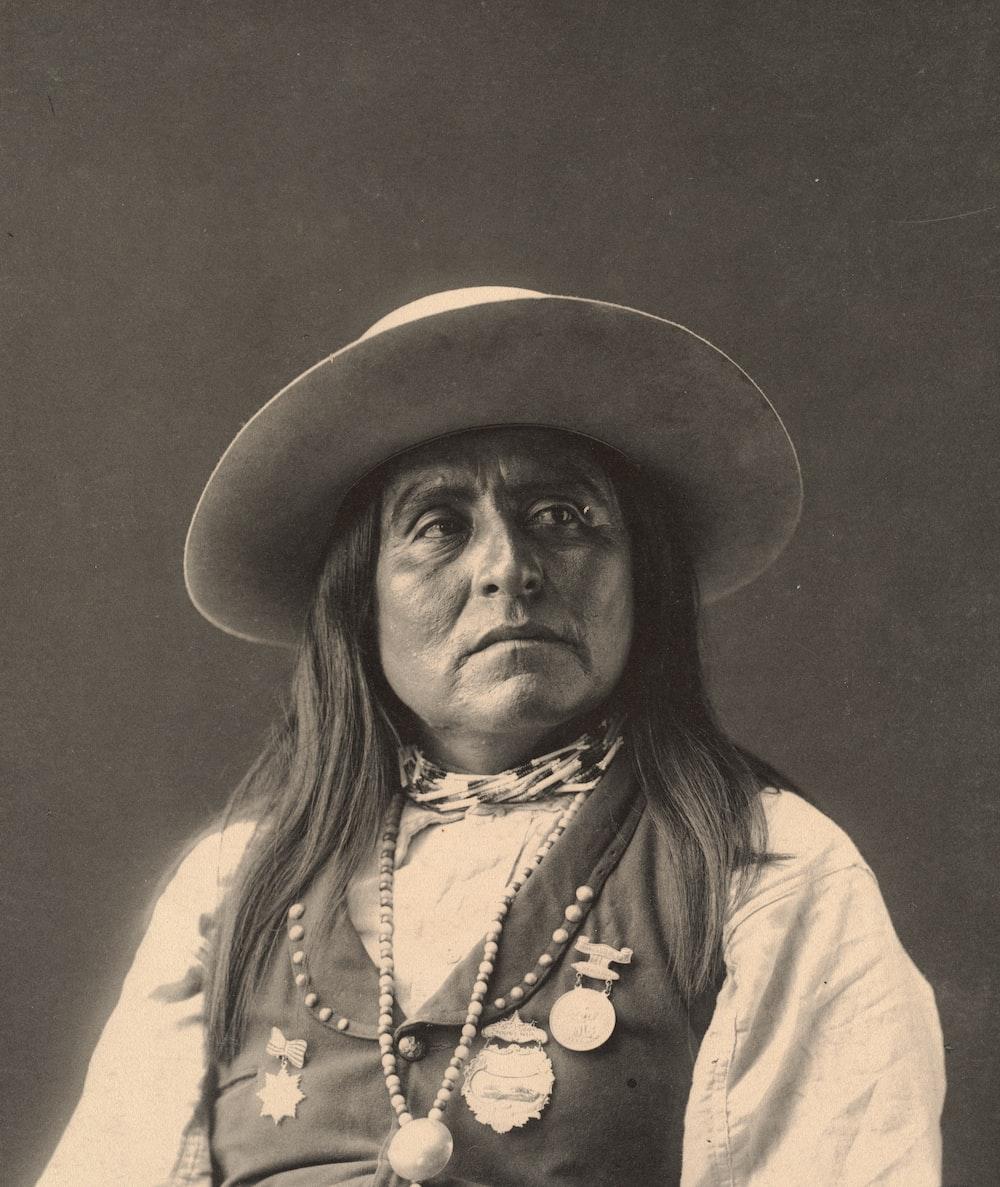 man in white shirt wearing black hat