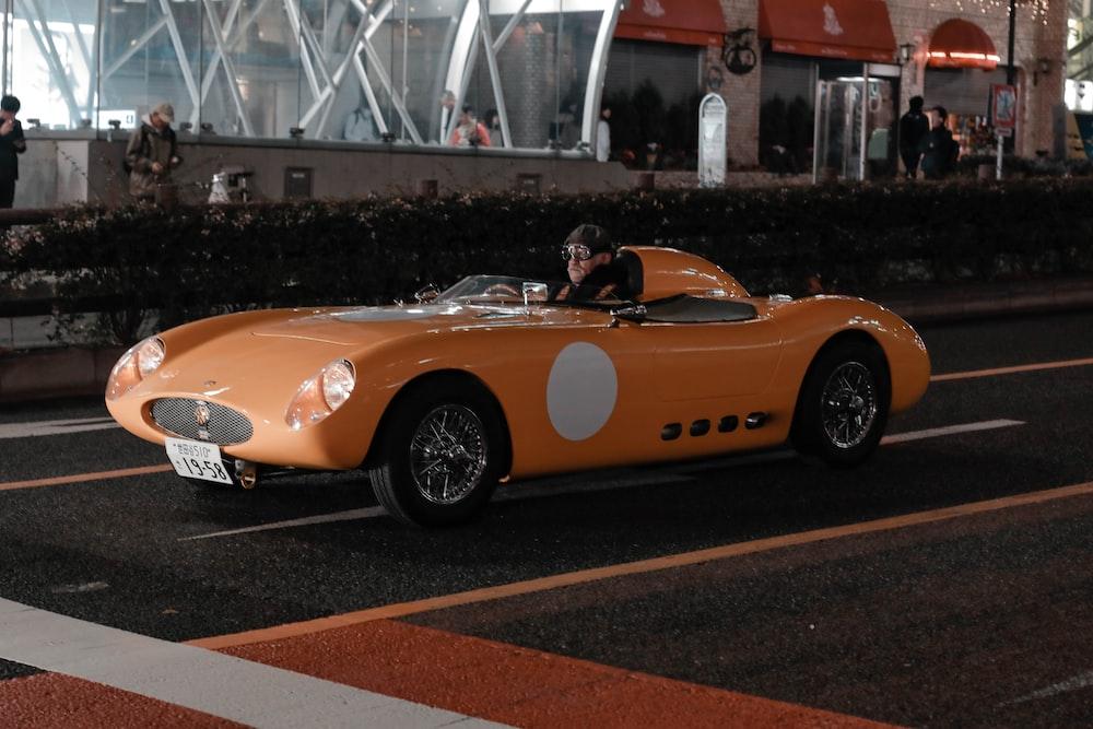 yellow ferrari 458 italia on road