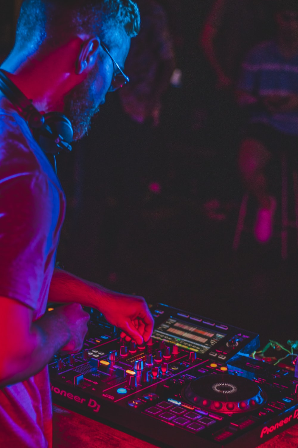 person playing audio mixer in concert