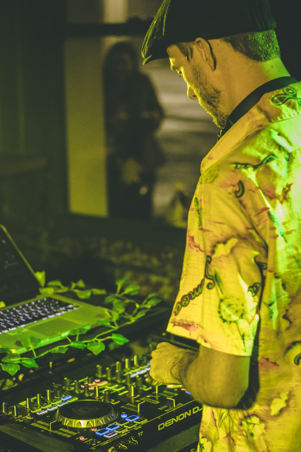 man in yellow and green floral button up shirt using computer