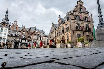 Nijmegen people walking on street near brown concrete building during daytime
