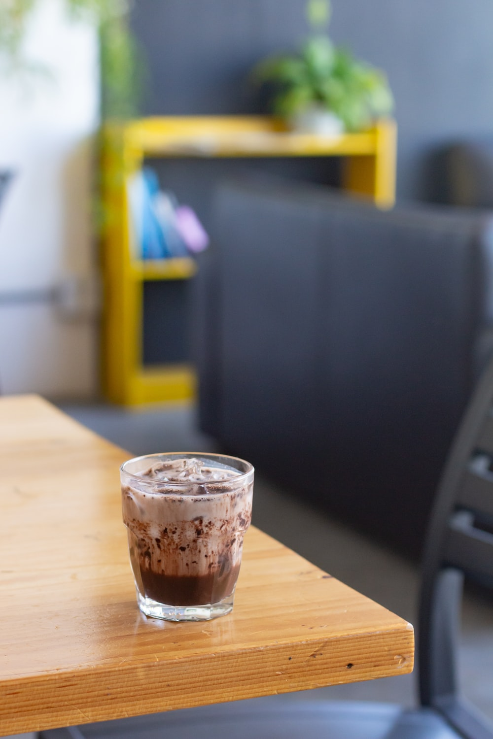 clear plastic cup on brown wooden table