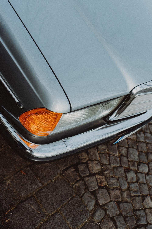 silver car on brown brick floor