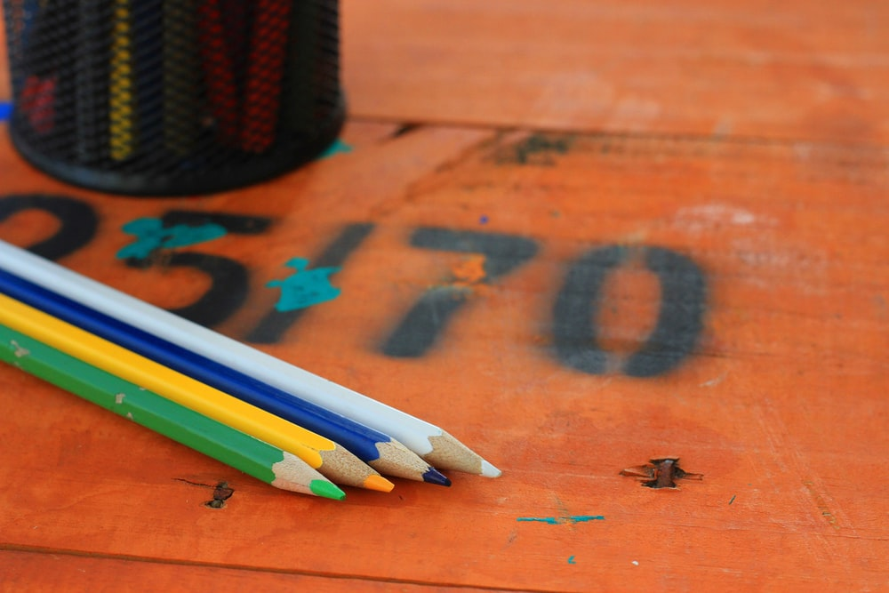 black pencil on brown wooden table