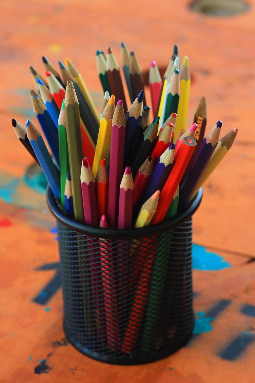 coloring pencils in black metal container