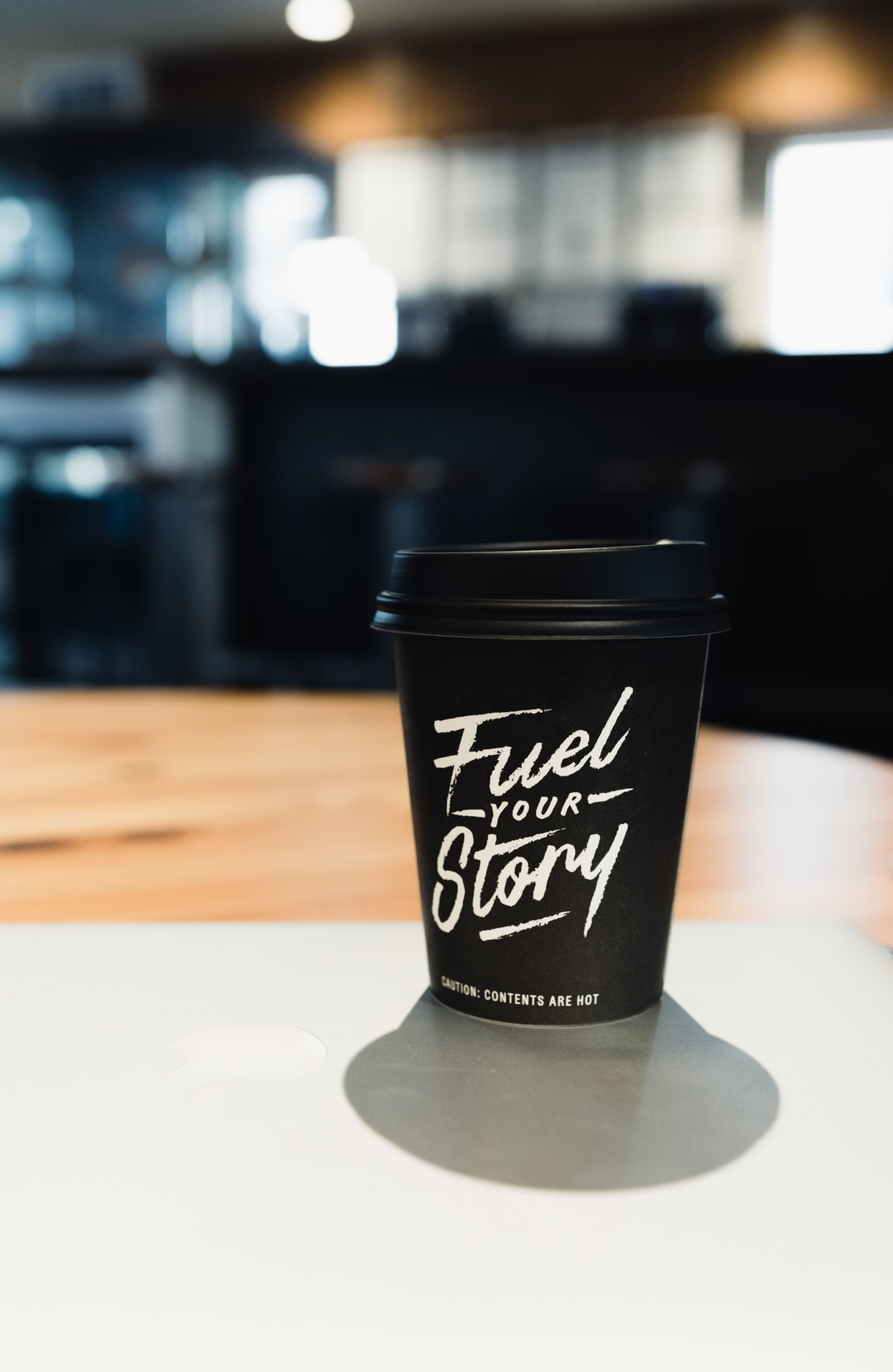 Coffee cup on table with inspirational quote