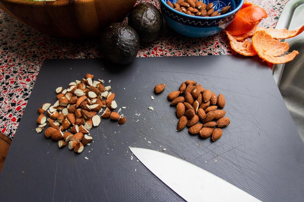 brown nuts on black textile