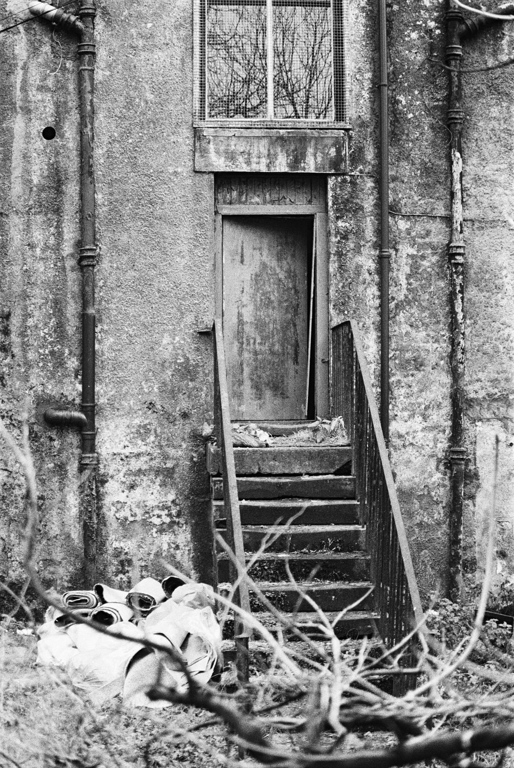 grayscale photo of wooden door