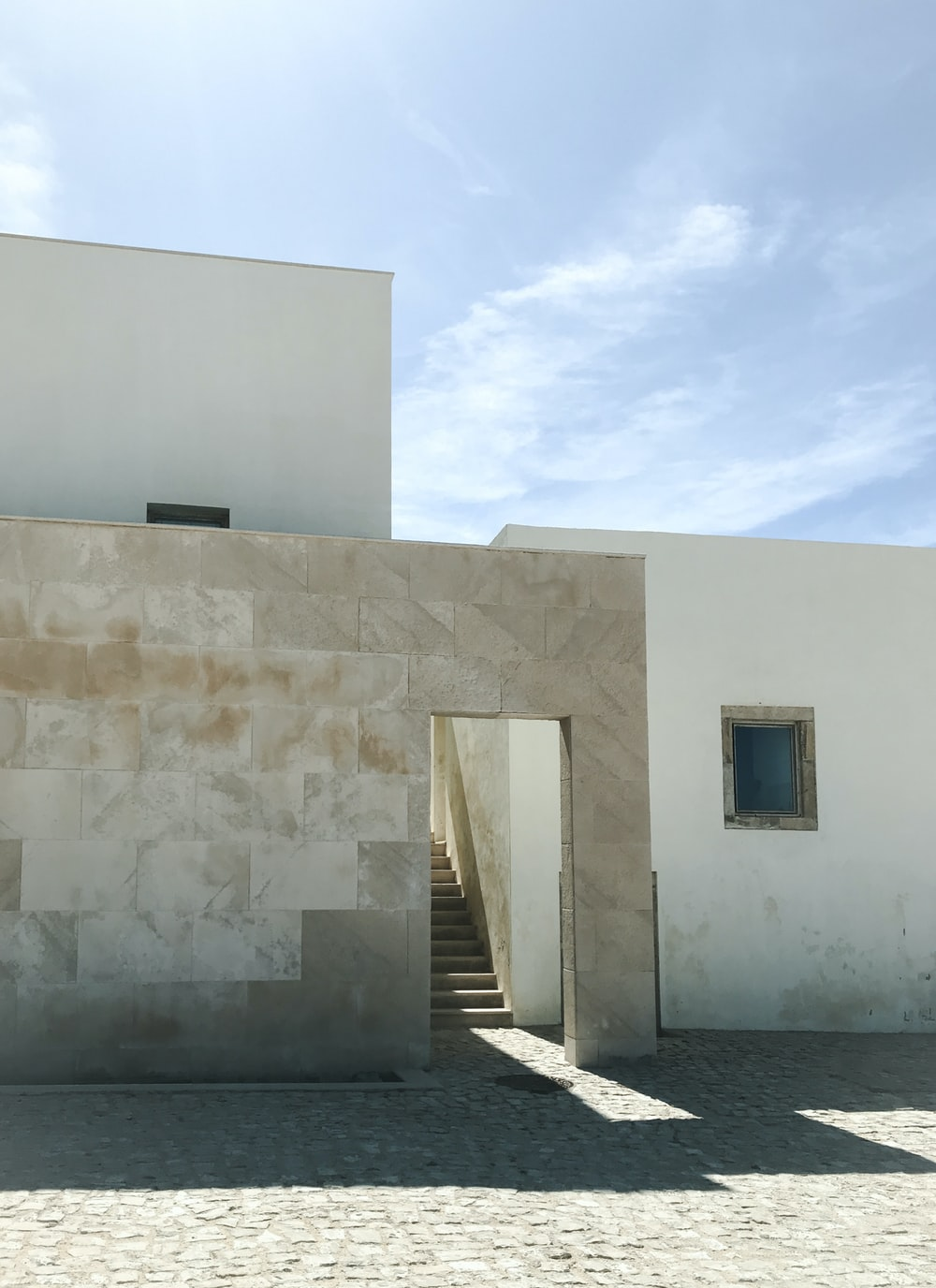 white concrete wall under blue sky during daytime