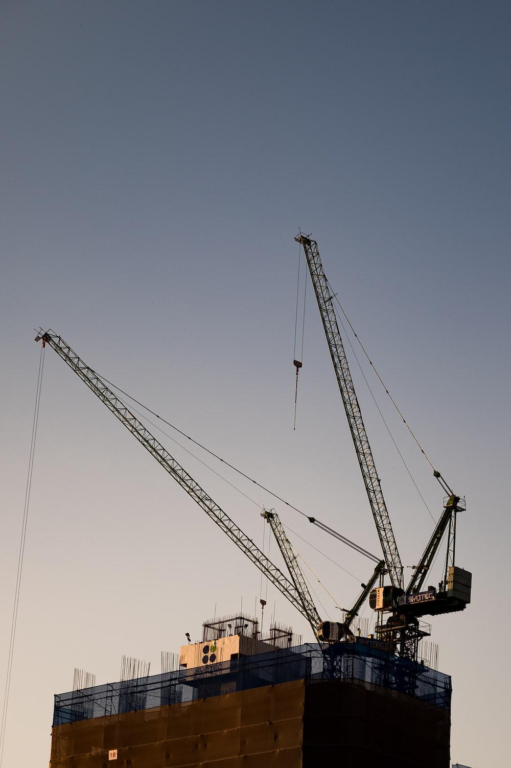 yellow crane under blue sky during daytime