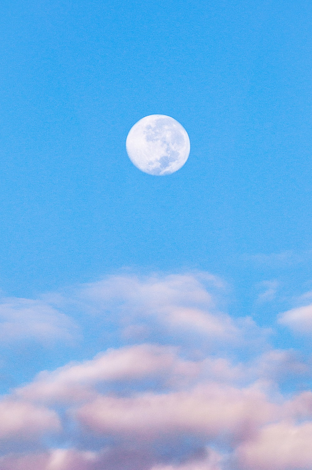 full moon in blue sky