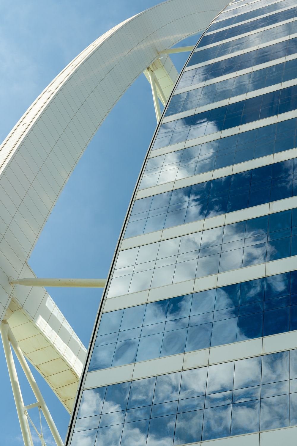 white and blue glass walled building
