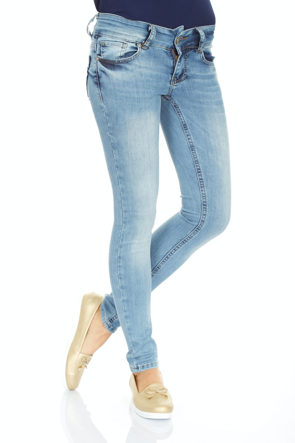 woman in blue denim jeans and white sneakers