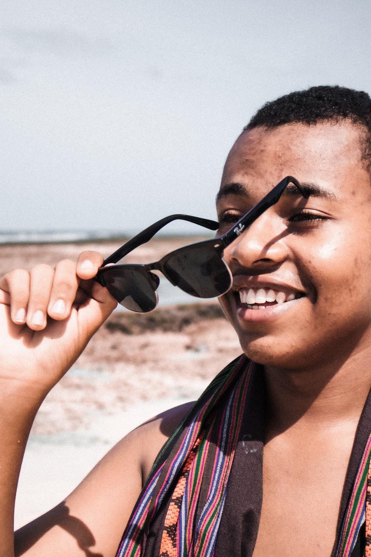 smiling woman in black sunglasses