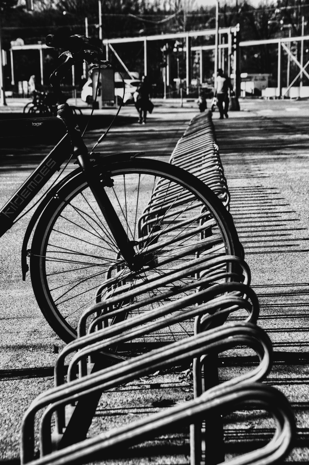 grayscale photo of bicycle on park