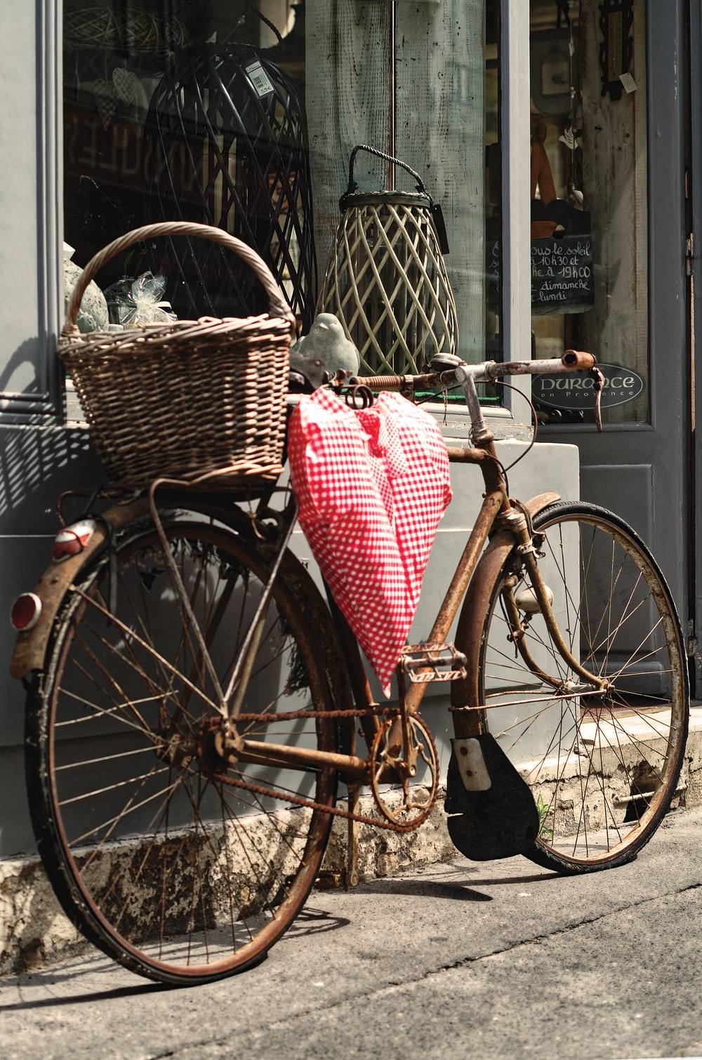 brown city bike with red and white plaid textile