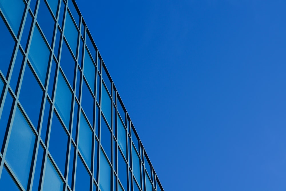 blue glass walled high rise building
