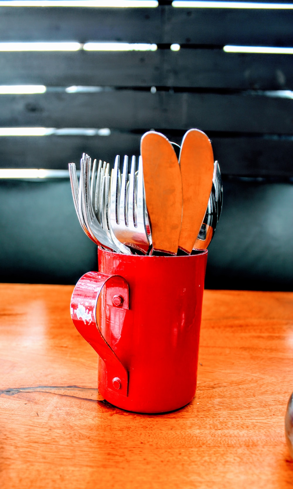 stainless steel fork and spoon in red ceramic mug