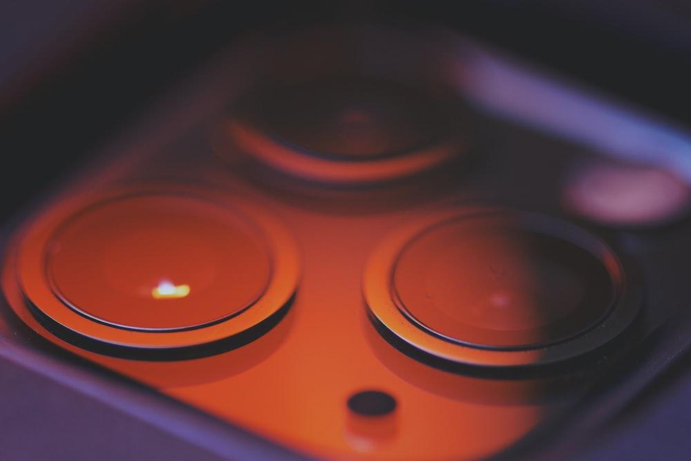 orange and black game controller